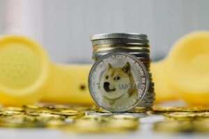 Dogecoin standing vertically, cheap cryptocurrency to buy